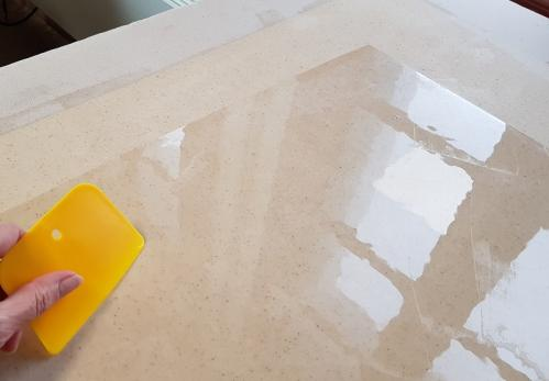 La mise en place du papier japon sur la toile